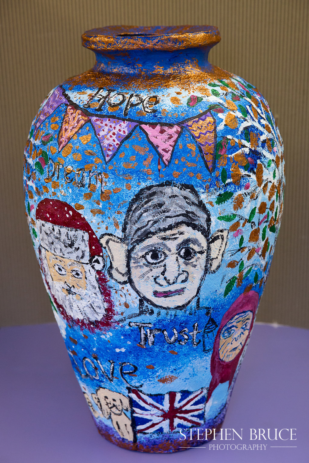 """Decorated papier-mache pot illustrating stories for the """"Tales from the Community"""" writing project - Y5 at Christ Church CE Primary School Chelsea RBKC"""