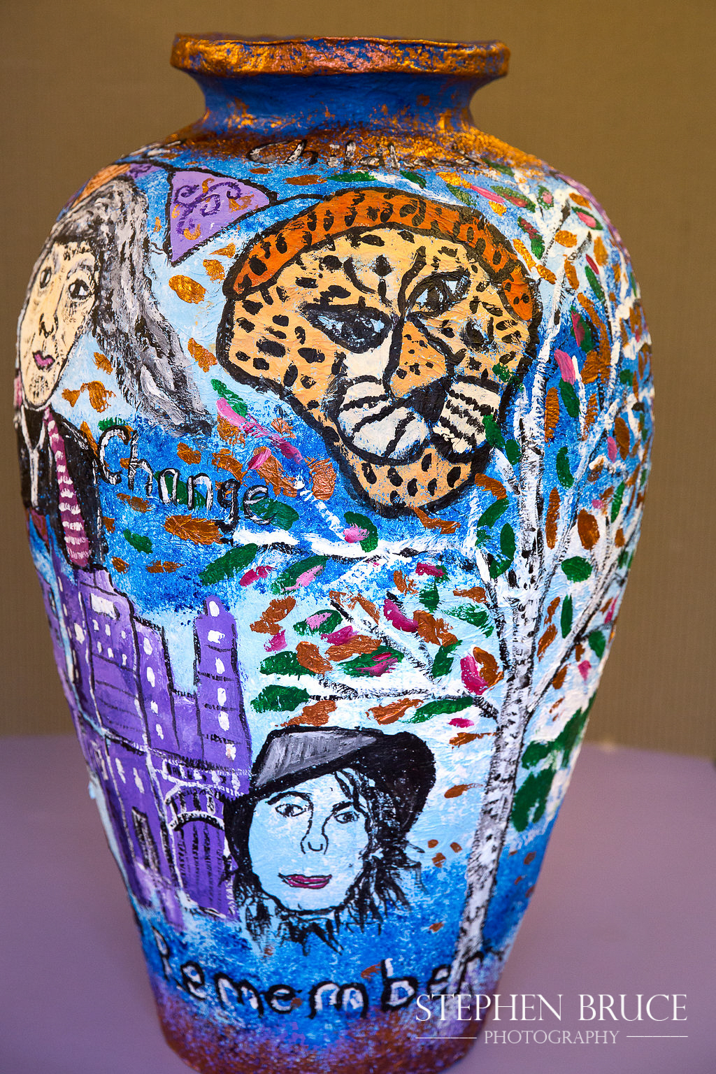 "Decorated papier-mache pot illustrating stories for the ""Tales from the Community"" writing project - Y5 at Christ Church CE Primary School Chelsea RBKC"